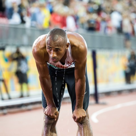 Damian Warner cools off after break the Canadian decathlon record.